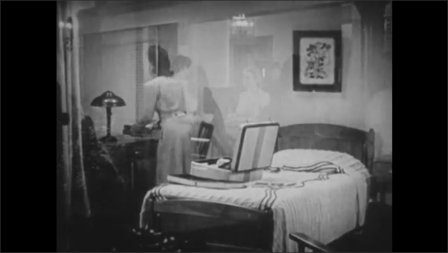 1940s: UNITED STATES: girls talk to nurse at reception. Girls unpack in room. Nurse greets new students