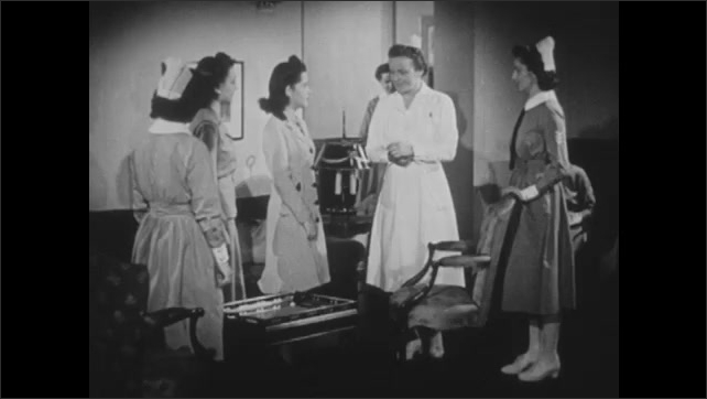 1940s: UNITED STATES: students talk to house mother at nurse school. Close up of watch on wrist. Hand turns off alarm by bed.
