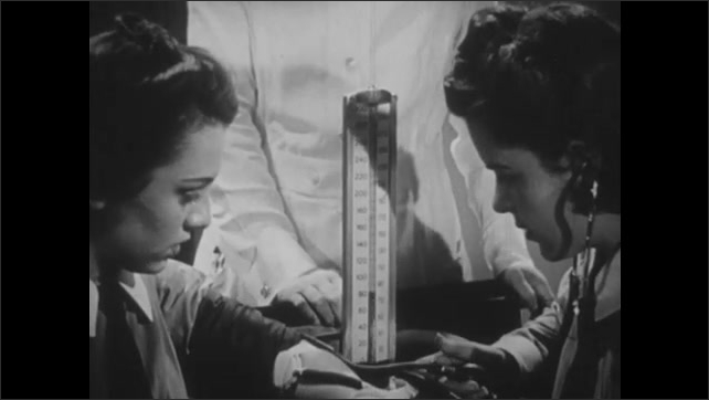 1940s: UNITED STATES: nursing students learn anatomy and physiology. Ladies learn to take blood pressure. Nutrition lesson. Students listen to lecture.
