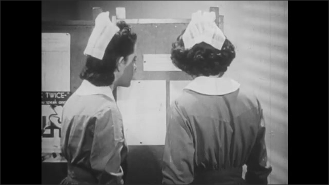 1940s: UNITED STATES: nurses look at exam results on notice board. Nurses smile at exam results. Nurses sit in ceremony. Man gives talk on stage.