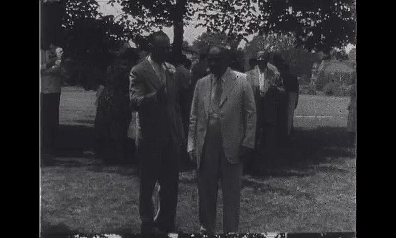 1940s: Wedding reception.  People pose outside.