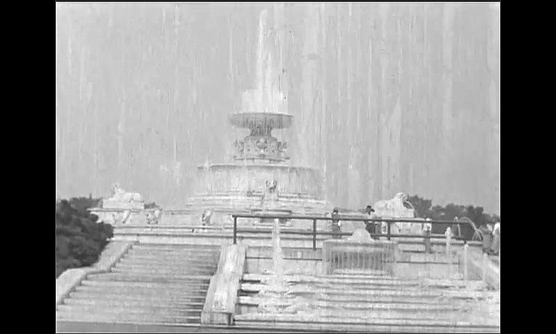 1940s: Families gather at picnic tables under trees. People walk past elaborate stone fountain.