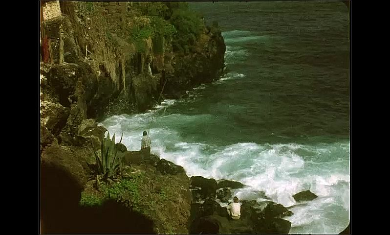 1970s: GRAN CANARIAS, EUROPE waves crash into cliff face and coast