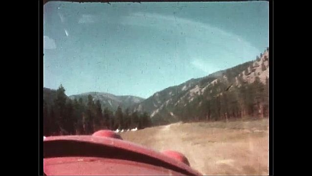 1950s: plane landing on a runway carved out in the forest