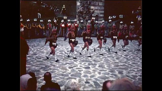 1950s: Men with swords and shields perform ceremonial dance, choreographed battle.