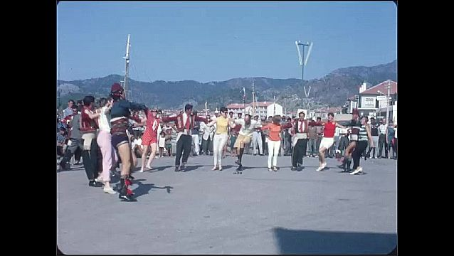 1950s: People dance in circle.