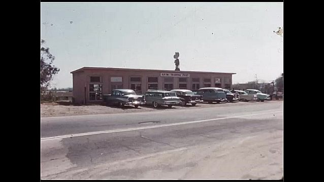1960s: View of book shelves. Exterior of store.
