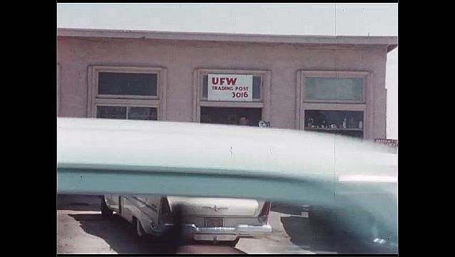 1960s: People standing by car outside of store. People climb into car. Man in doorway of store.