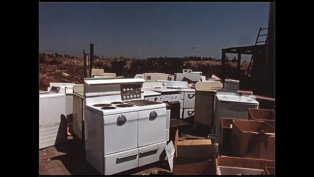 1960s: View of stoves in outdoor lot.