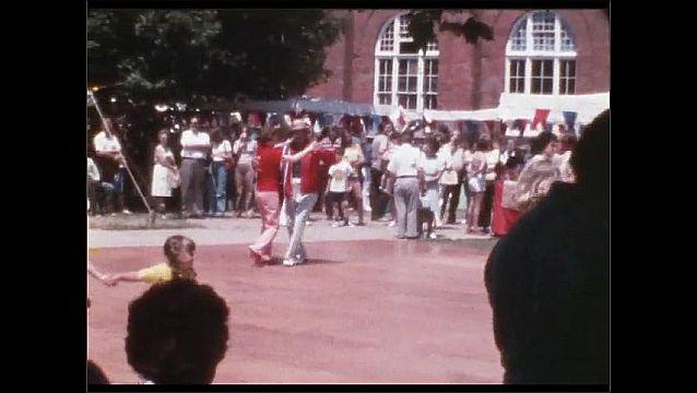 1960s: People dance on outdoor dance floor.