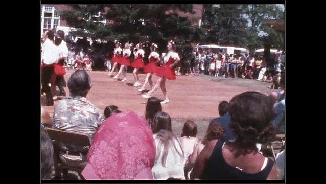 1960s: Dancers perform on outdoor dance floor. Crowd watches.