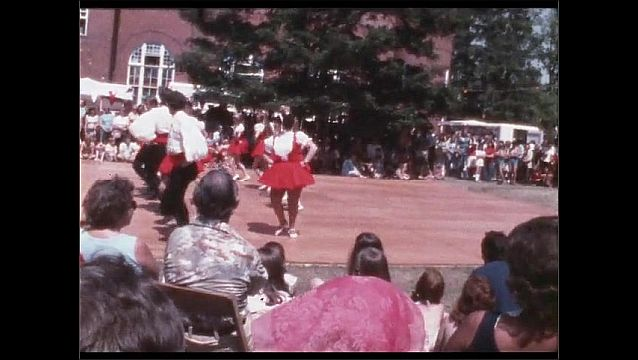 1960s: Dancers perform on outdoor dance floor. Crowd watches.