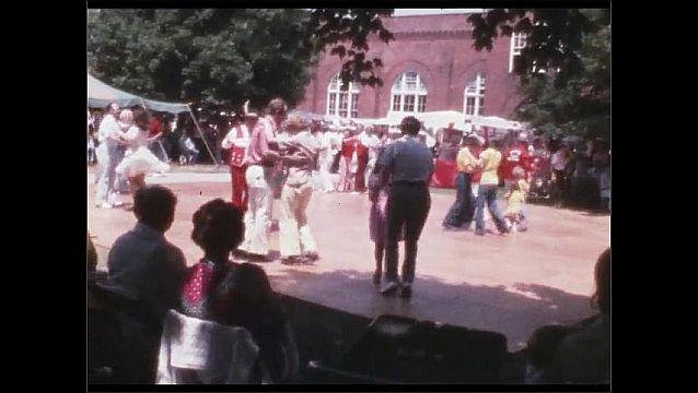 1960s: People dance on outdoors dance floor.