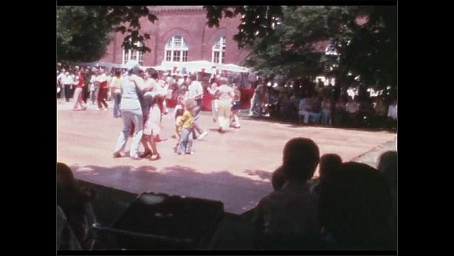 1960s: People dance on outdoors dance floor.