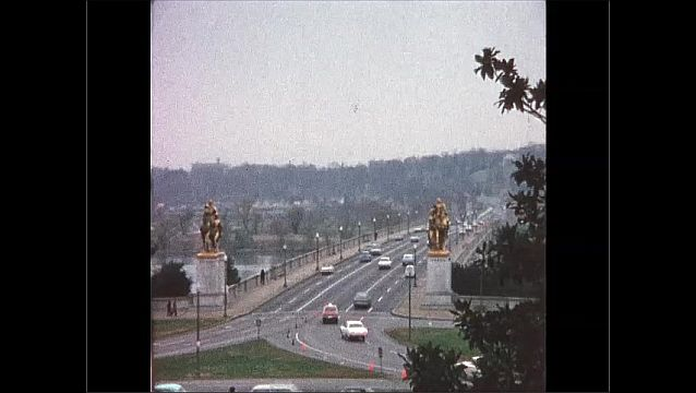 1970s: UNITED STATES: statue of American President in chair. View along road across bridge. Obelisk and water feature.