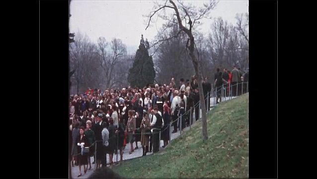 1970s: UNITED STATES: people attend memorial service in gardens.