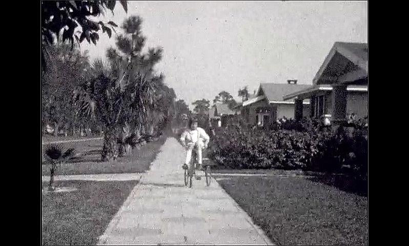 1920s: UNITED STATES: girl skates towards camera. Girl rides trike towards camera.