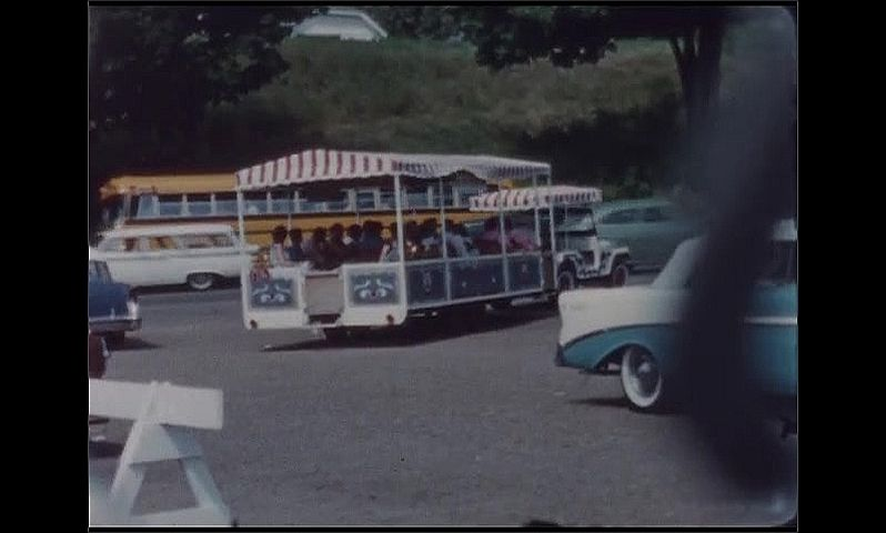 1960s: UNITED STATES: visit to Circus World Museum. Vehicle takes people to museum. Winter Quarter's Shop sign.