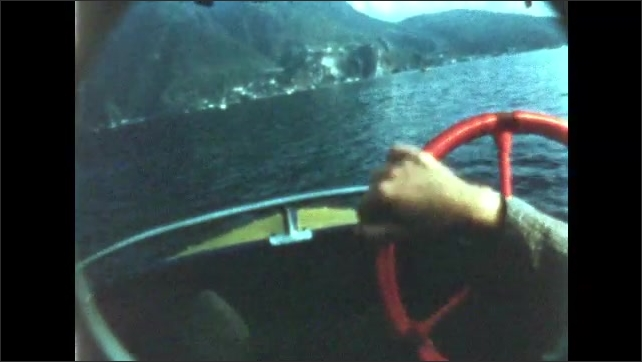 1950s: small two-person boat driving around lake, sign for San Gottardo