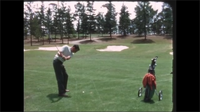 1960s: Golf course, trees, rolling golf bag, man takes practice swing, hits ball, swings club over shoulder, watches. Hills, sand traps, man hits ball, leans, looks, turns around, smiles.