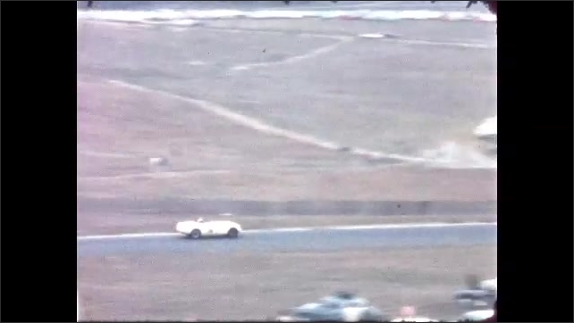 1960s: racecar turning onto a straight run of track and then making a turn