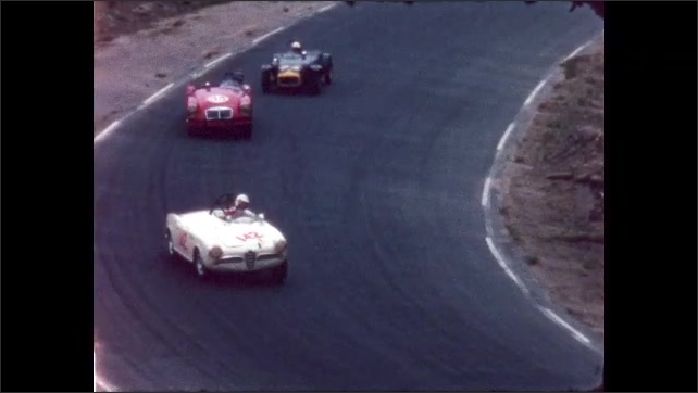 1960s: three racecars driving around a curve