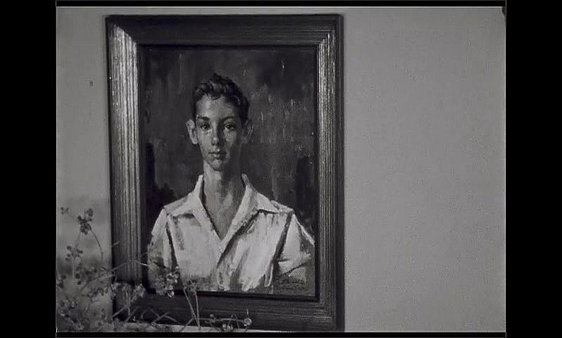 1940s: UNITED STATES: by stands by portrait painting.