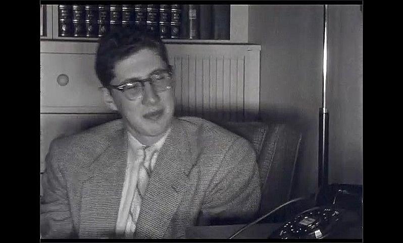 1940s: UNITED STATES: boy smiles at camera. Boy waves at camera. Boy reads magazine. Boy speaks on phone