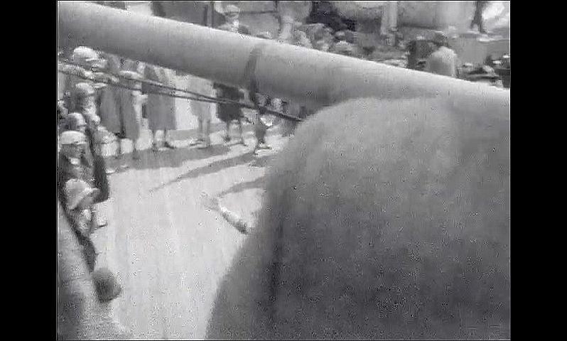 1920s: UNITED STATES: man in suit and cap on deck. Men play with large ball on deck People play sports on deck. Man putting on deck of ship