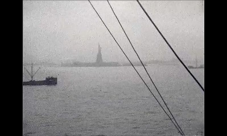 1920s: UNITED STATES: ships coming in to New York port. Statue of Liberty viewed from ship.