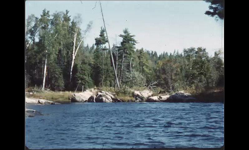 1940s: Boating across lake towards shore.