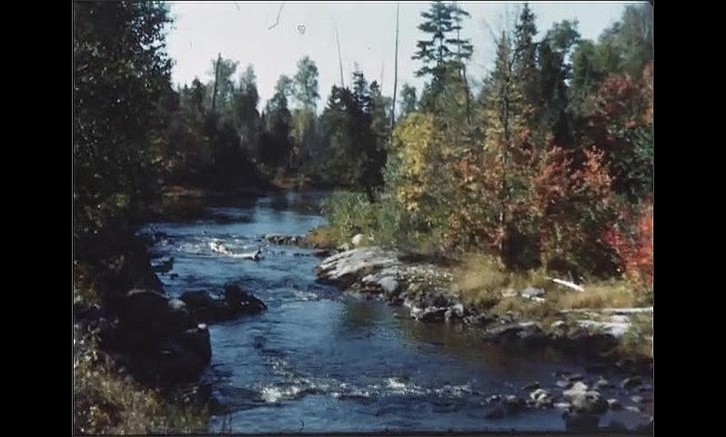 1940s: Water flows down stream in river.