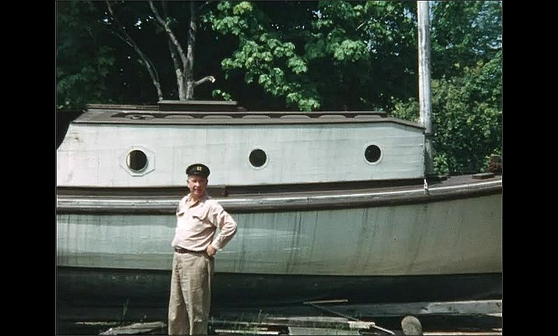 1940s: UNITED STATES: man with tool box. Man stands by boat. Fish on line. Man holds up fish for camera.