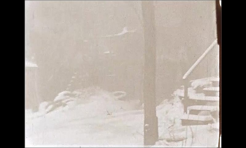 1940s: ONTARIO, CANADA: fire crew put out fire in snow. Men with fire hose.