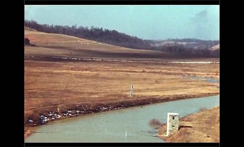 1940s: UNITED STATES: water in reservoir. Sluice gates in river. View across flood plains