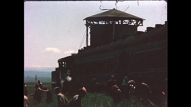 1940s: People exit train, walk out in to field.
