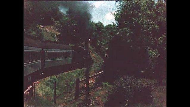 1940s: Train travels along mountainside.