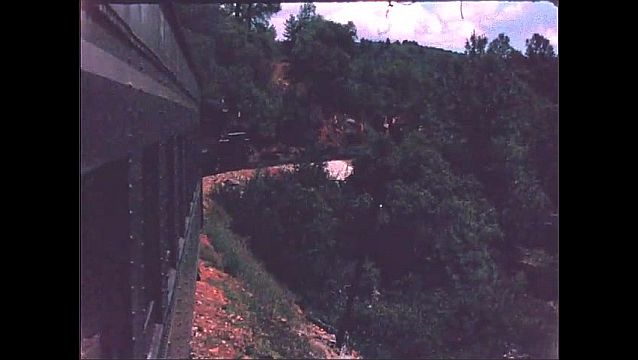1940s: Train travels along mountainside.