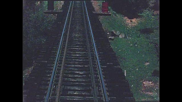 1940s: Train tracks over bridge.