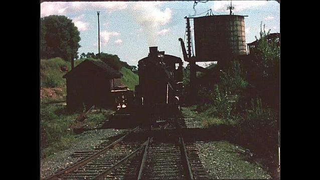 1940s: Train travels past coal silo.