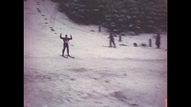 1940s: Skier jumps down slope and crashes at bottom. Skiers successfully jump ramp and ski down snowy slope.