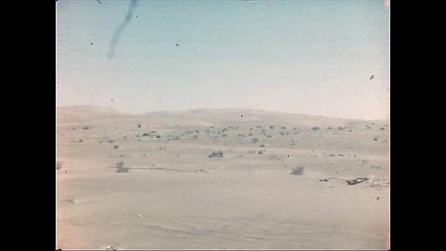 1940s: Car drives down winding desert roads.