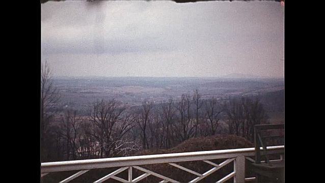 1940s: UNITED STATES: building and grounds in Autumn. View across landscape from viewing point