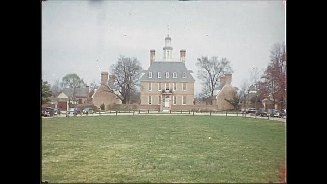 1940s: UNITED STATES: trees and view through garden. Building and grounds. Cars in street. Site of First Theatre in America.