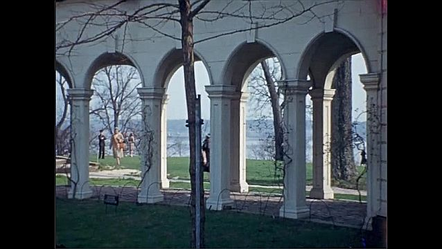 1940s: UNITED STATES: Visit to Mt Vernon. Building and park. Arches in park. People in park. Boy walks along path.