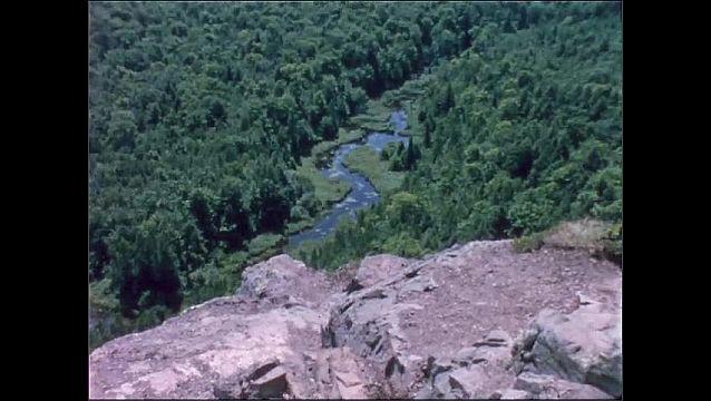 1950s: Lake, trees, river, mountains.