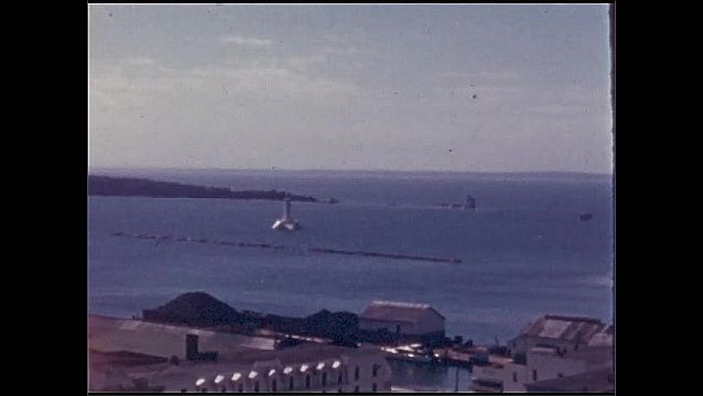1940s: UNITED STATES: view across coastline and sea from high point on land.