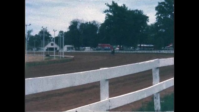 1970s: UNITED STATES: horse pulls cart around track.