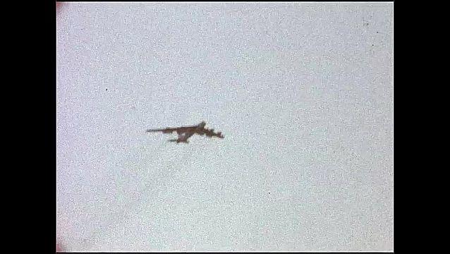 1940s: Airplane flies in sky.