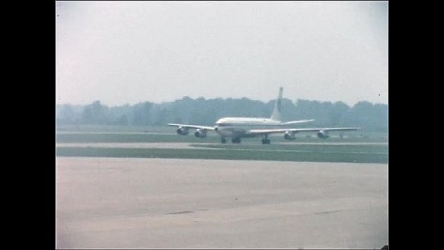 1960s: UNITED STATES: plane on runway. Plane prepares for take off. Plane in queue
